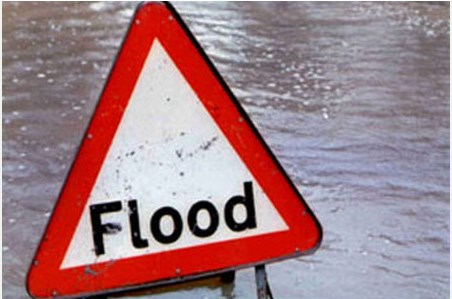 Flood waters and sign